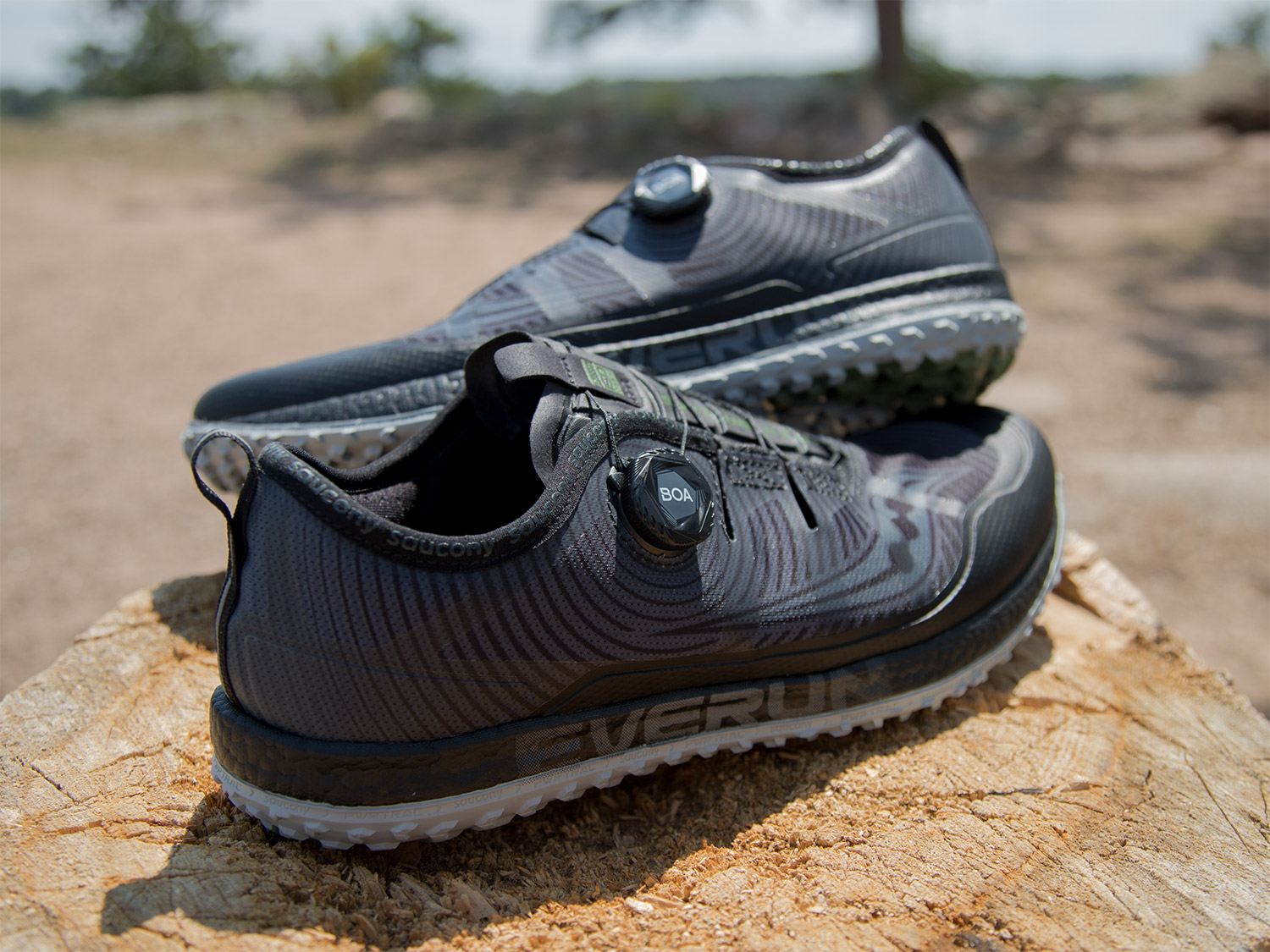 Saucony Switchback ISO sitting on log for display