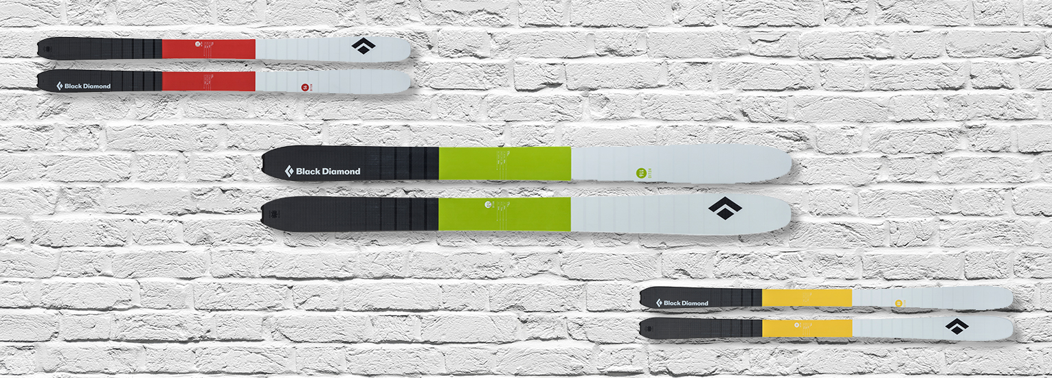 Black diamond skis on white brick wall