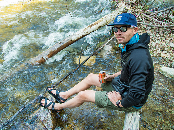 Man sitting by river in Chaco Lowdown Shoes